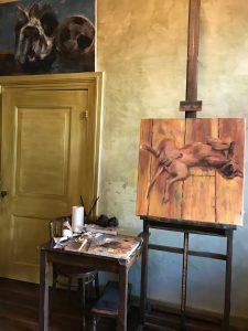 Een olieverf schilderij staat op de ezel. Rocker, mijn hond, heb ik geschilderd